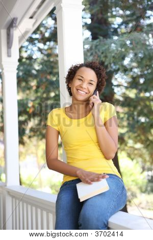 African American Woman On Porch