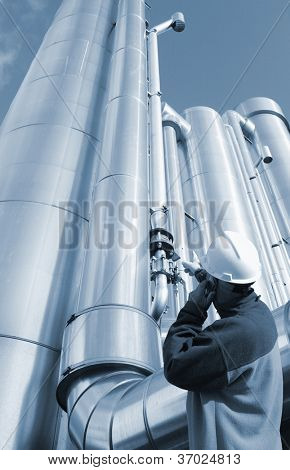 gas worker and giant gas pipelines, blue toning idea