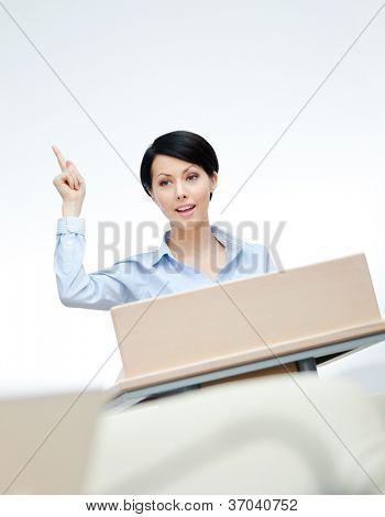 Female executive at the podium. Business seminar