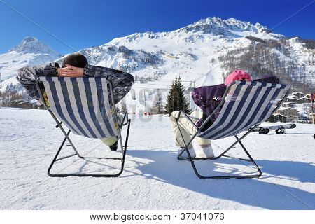 Couple at mountains in winter, Val-d'Isere, Alps, France