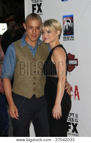 """LOS ANGELES - SEP 8:  Theo Rossi. Sarah Jones arrives at the """"Sons of Anarchy"""" Season 5 Premiere Screening at Village Theater on September 8, 2012 in Westwood, CA"""