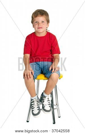 Boy sitting on stool isolated on white
