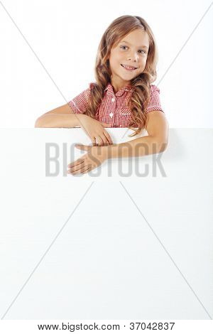 Portrait of a child girl with blank board for custom text