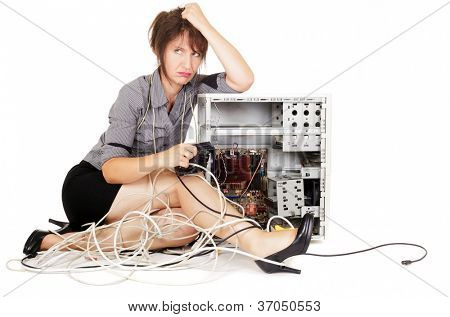 worried woman sulking with broken computer