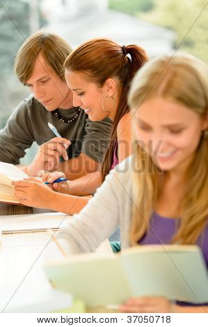 Teens study in high-school library reading student college learning campus