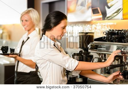 Staff at cafe making coffee espresso machine woman working bar