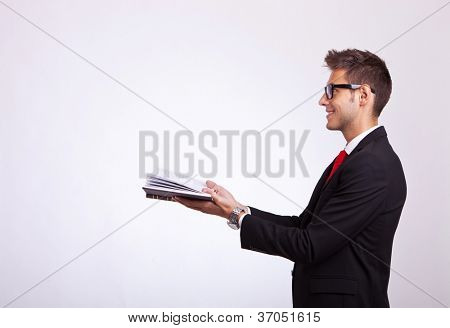 side view of a student looking at something imaginary comming out of his book