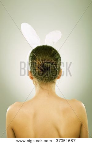 back of a sexy woman wearing bunny ears - vintage image style