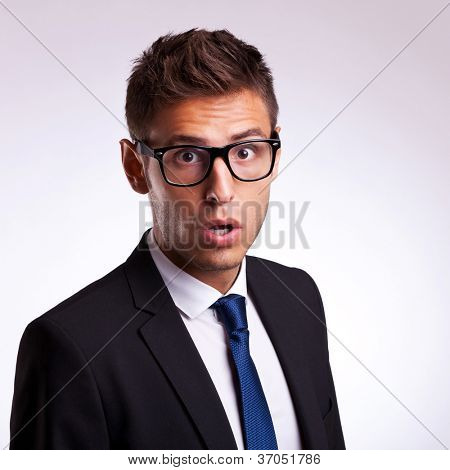 portrait of astonished young business man or student