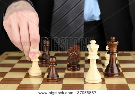 businessman playing chess close-up