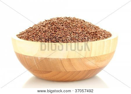 flax seeds in wooden bowl isolated on white background