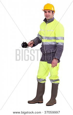 Construction worker with a piggy bank