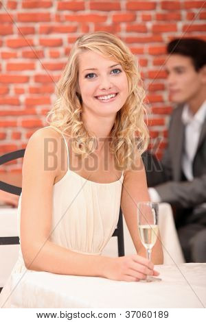 Woman in restaurant with a glass of champagne