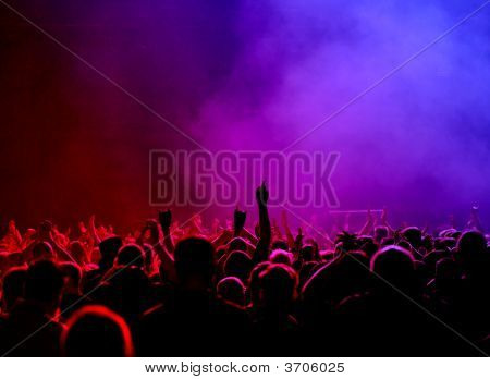 Concert Crowd In Red To Violet Light
