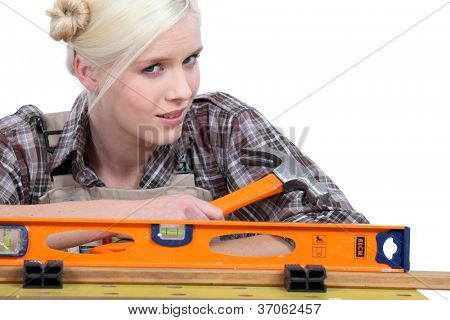 blonde holding a hammer