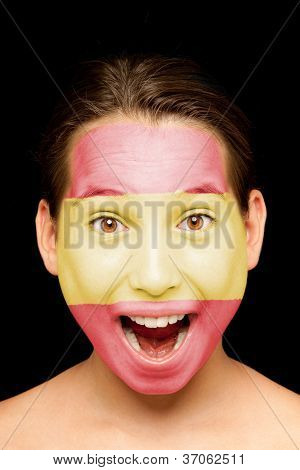 portrait of girl with spanish flag painted on her face
