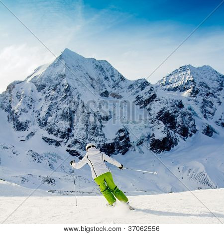 Skiing, winter, woman skiing downhill