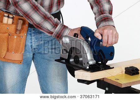 Mason using circular saw