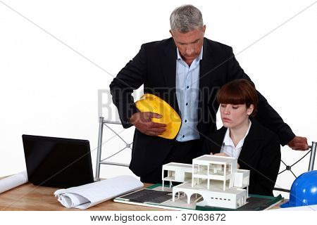 Experienced architect giving a young colleague advice