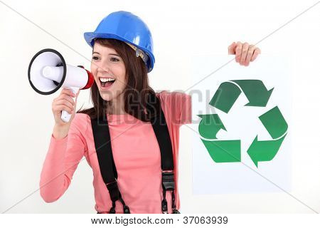 young woman holding bullhorn and sign with recycling symbol