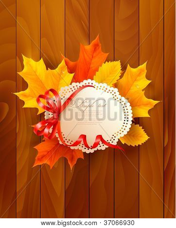Card with leaves with a bow on wooden background. Vector.
