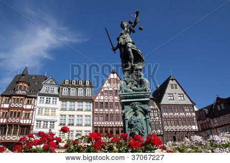 FRANKFURT, GERMANY - AUG 23: The Statue of Lady Justice in Romer Square on August 23, 2012 in Frankfurt, Germany. Romer Square had been the site for the Frankfurt city government for over 600 years.