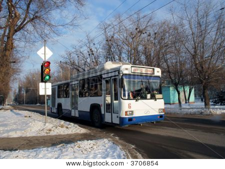 Trolley Bus On A Crossroads