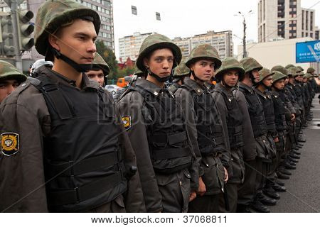 MOSCOW - 15 SEPTEMBER: Police officers cordon a street as opposition supporters march for a anti-Putin protest rally on September 15, 2012 in Moscow.