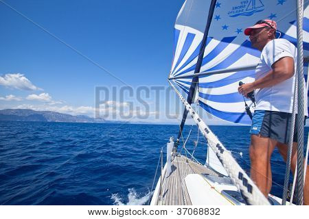 MEDITERRANEAN SEA, TURKEY- MAY 29: Unidentified sailor participates in sailing regatta Sail & Fun Trophy 2012 from Marmaris to Fethiye, May 29, 2012 in the Mediterranean Sea, Turkey.