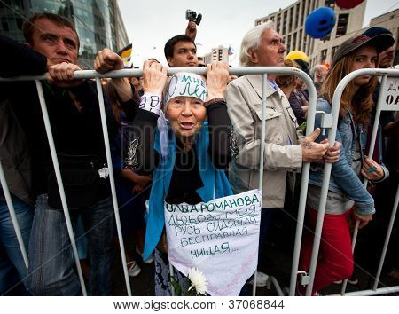 MOSCOW - 15 SEPTEMBER: A old woman takes part in an anti-Putin protest in central in Moscow on September 15, 2012 in Moscow. Thousands marched through Moscow to protest against the rule of V.Putin.