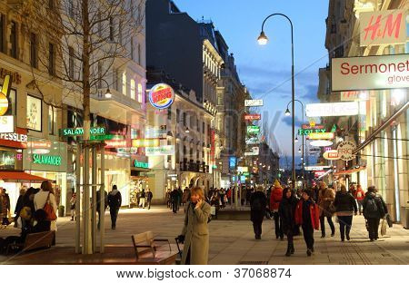 VIENNA- FEB 20: People go on main pedestrian street Kartner Strasse at night on Feb 20, 2012  in Vienna, Austria. Vienna Kartner Strasse street is the main shopping street in Vienna.