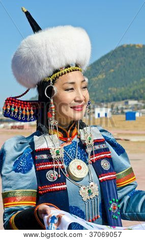 ULAN-UDE, RUSSIA - SEPTEMBER 15: Cultural program of Baltic Economic Forum. An unidentified woman in national dress Buryat greets guests of festival., September 15, 2012 in Ulan-Ude, Buryatia, Russia