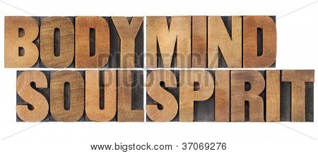 body, mind, soul and spirit - a collage of isolated words in vintage wood letterpress printing blocks
