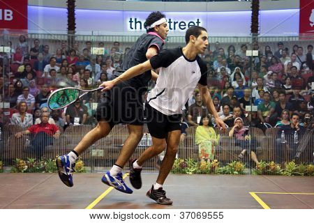 DAMANSARA - SEP 15: Mohamed El Shorbagy (black) shoves Tarek Momen in the men's final of the CIMB Malaysian Open Squash Championships 2012 held in Damansara, Malaysia on September 15, 2012. Momen won.