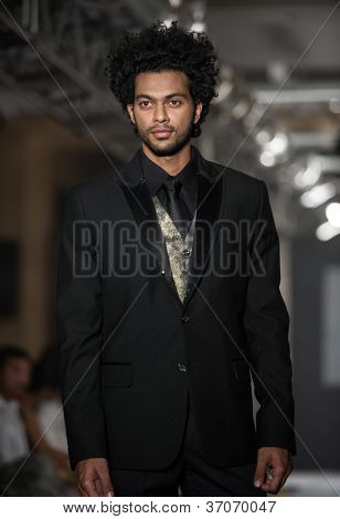 CHENNAI - JULY 21: A model walks on the ramp showcasing designer chaitanya Rao work during the Chennai International Fashion Week runway on Jul 21, 2012 in Chennai , India.