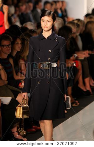 NEW YORK - SEPTEMBER 12: A model walks the runway at the MICHAEL KORS Spring/Summer 2013 collection Mercedes-Benz Fashion Week in New York on September 12,2012