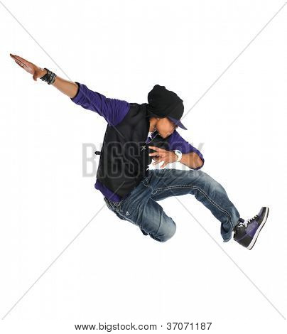 African American hip hop dancer jumping over white background