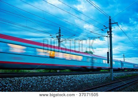 a passenger train travels through the night. night train with people of �?�?�?�¶bb