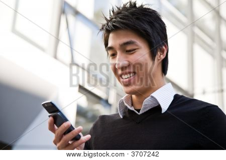 Casual Asian Businessman Texting