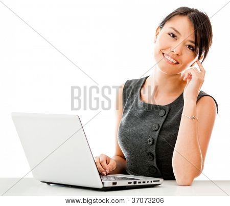 Business woman working on a laptop - isolated over a white background