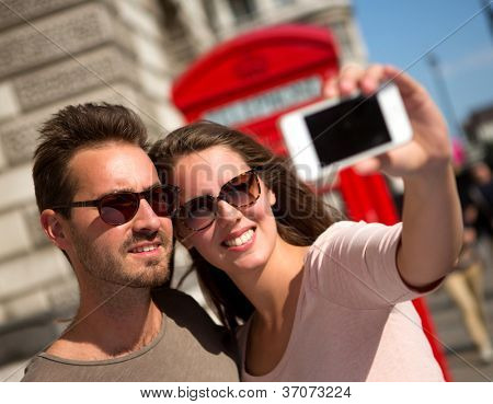 Couple taking a self portrait in the streets of London