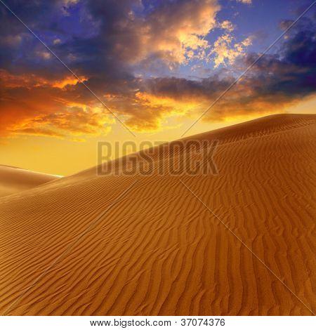 Desert sand dunes in Maspalomas sunset Gran Canaria at Canary islands [Photo illustration]