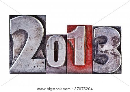 The numbers or date 2013 in old worn letterpress, isolated on a white background.