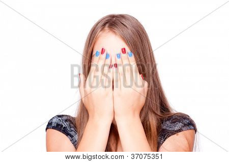 Teenage girl playing hide-and-seek, isolated on white