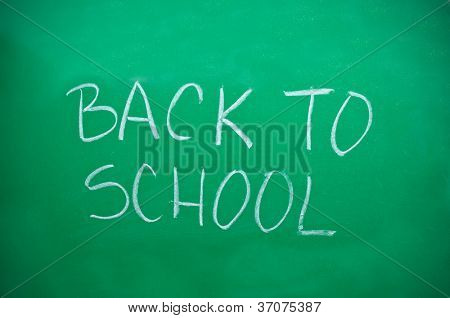 "Green school board with words ""Back To School"""