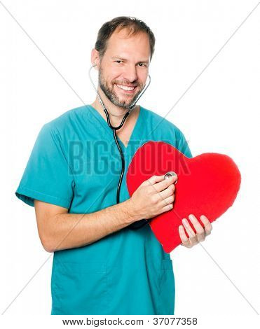 A male doctor examining a red heart shaped pillow with a stethoscope against white background