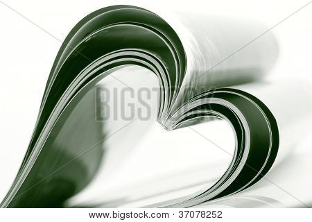 Selective focus image of magazine folded into a heart shape