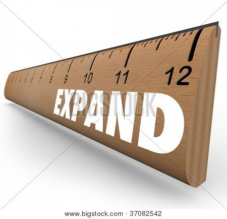 A wooden ruler with the word Expand to symbolize business expansion or growth of personal level or other quality