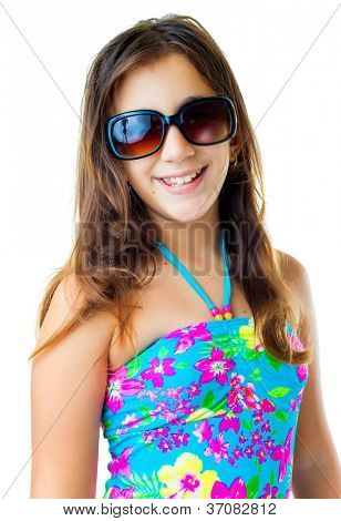 Cute hispanic girl wearing a swimsuit and dark sunglasses  smiling isolated on white