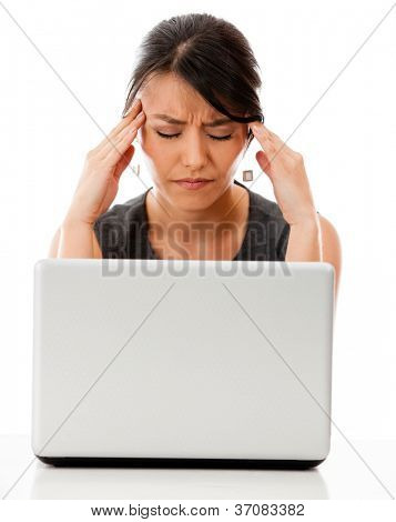 Stressed business woman working on a laptop - isolated over white